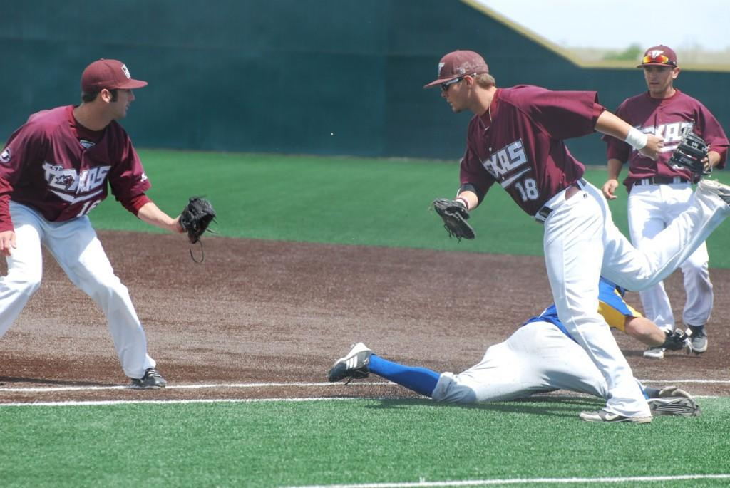 Justin Kuks, Parker Wood and Cody Wright try to tag out the runner. Photo by Melissa Bauer-Herzog.