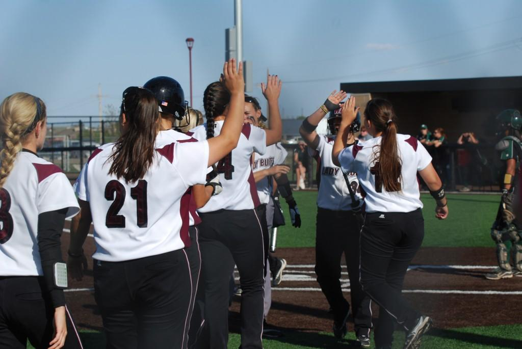 The Lady Buffs celebrate after their first run of the third inning.  Photo by Melissa Bauer-Herzog.