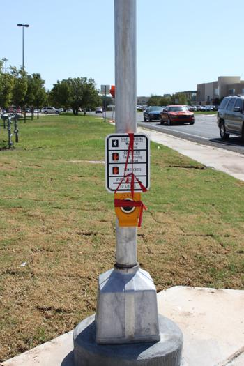 Tape covers the crosswalk sign. Photo by Katelyn Garrity.