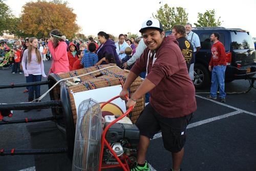 Junior Andrew Santos volunteers with setting up the ladybug hot air balloon. Photo by Danie Fierro.