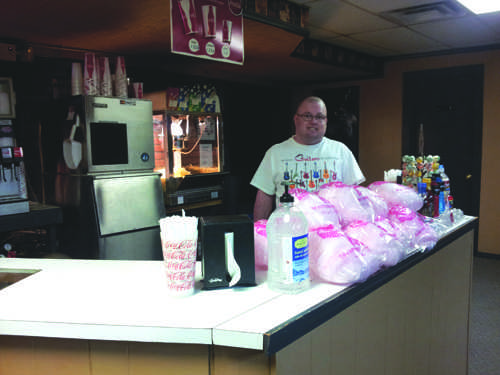 JJ Wilbur stands in the concession stand where he works, picture by Daniela Fierro.