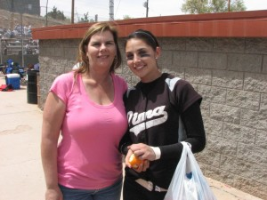 Mercedes Garcia (right) and her mother Marchelle (left) at one of Mercedes softball games at Pima College. Photo courtesy of Garcia family.
