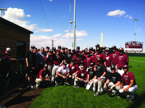 WT baseball team poses with Tim Tebow (center) after practice. Photo courtesy of Kasey Lish.