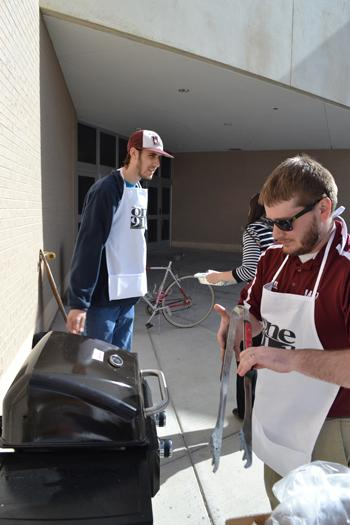 Senior Travis Lubbe and Broadcast Engineer Johnny Story cook out for an advising party. Photo by Alex Montoya.