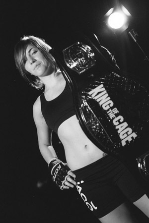 Photo courtesy of Sarah Alpar. Alpar shows off her King of the Cage title belt.