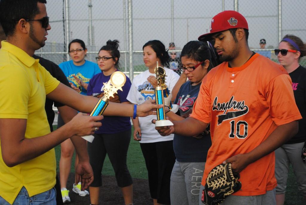 """ATO members handed out trophies to team member for the winning team, """"2 Legit."""" Photo by Lisa Hellier."""