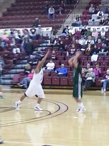 Senior Kennon Washington contests ENMU Shot. Photo by Matt Watkins.