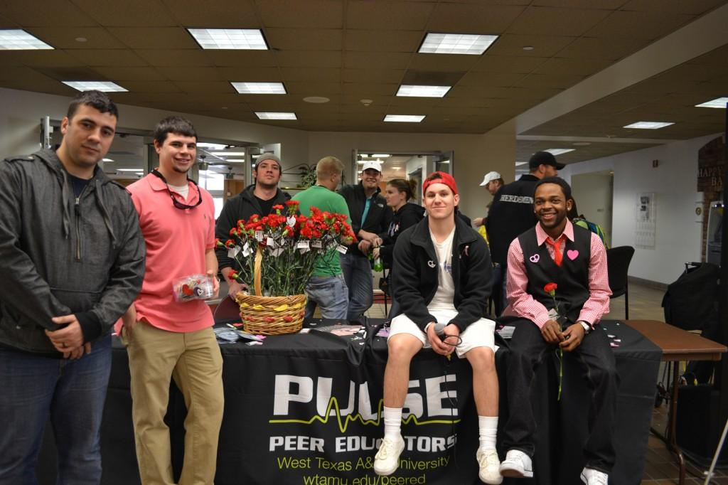 Pulse hands out contraceptives and flowers for Sexual Responsibility week. Photo by Alex Montoya.