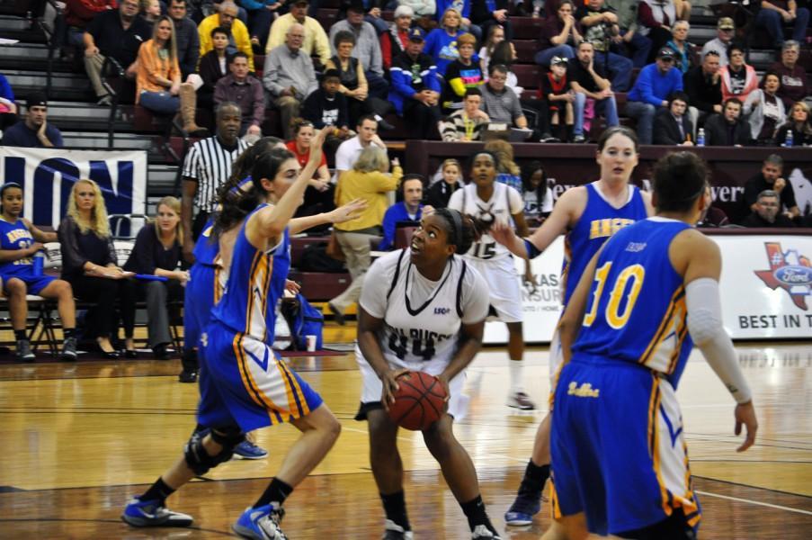 Sophomore Chontiquah White drives the lane against ASU. Photo by Cale Bloskas.