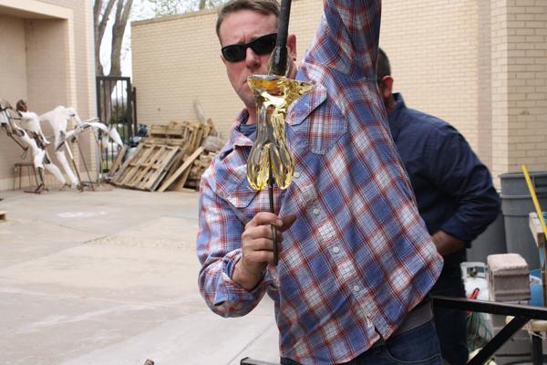 Artist Robert Stern working on an example sculpture for glass blowing class.