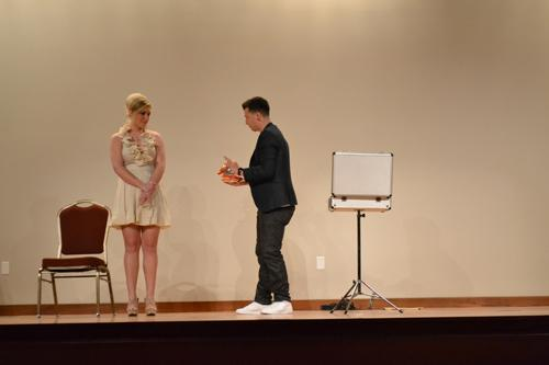 Junior Belynn Sharp paricipates in the magic show with magician Matt Franco. Photo by Alex Montoya.