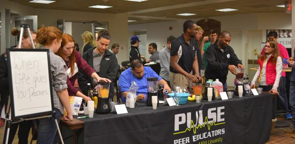 Students participate in the PULSE 'When Life Gives You Peaches' mocktail contest. Photo by Alex Montoya.