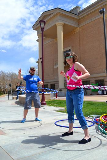 Prevention Educator David Boaz and Senior Chenoa Burleson hula hoop with Family Support Services. Photo by Alex Montoya.