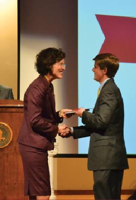 Junior Leif Knippers accepting the Jack B. Kelly Scholarship award. Photo by Alex Montoya.