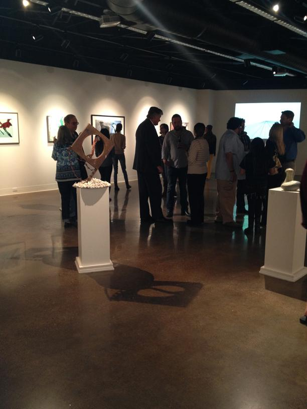 Patrons congregate during the art exhibition. Photo by Sterling Rusher.