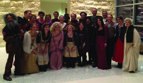 The cast gathers after the show for a group photo.