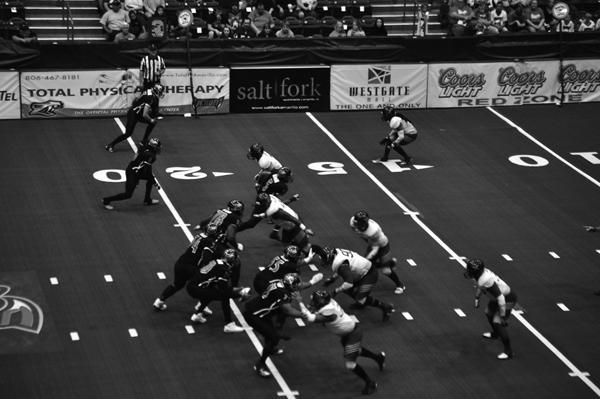 Amarillo Venom offense, led by quarterback Brendan Crawford, drive down the field.
