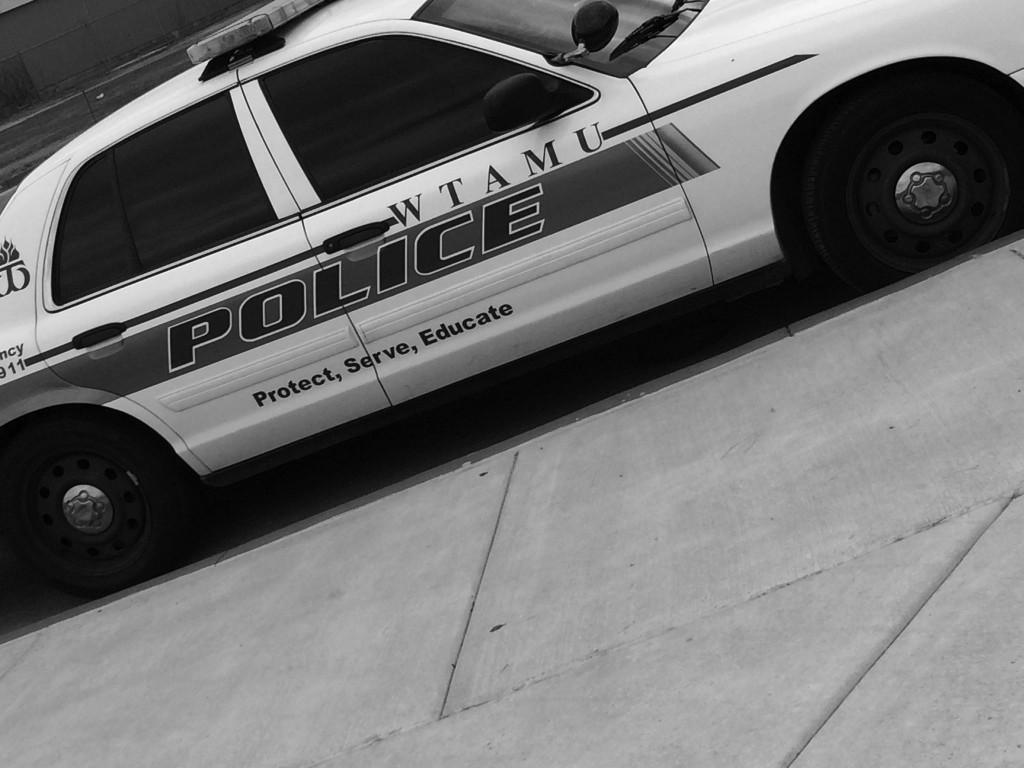 WTAMU campus police car is parked next to curb.